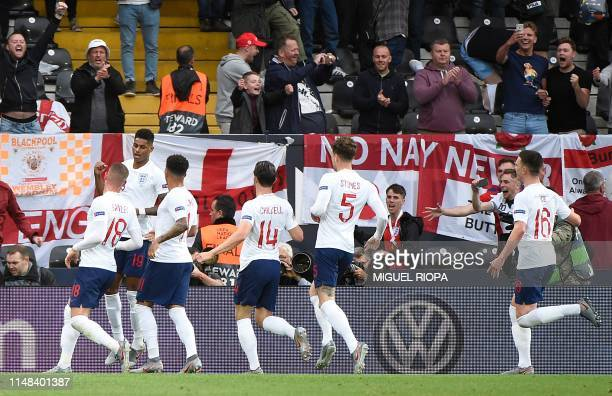 England's forward Marcus Rashford celebrates with teammates after scoring a goal during the UEFA Nations League semifinal football match between The...