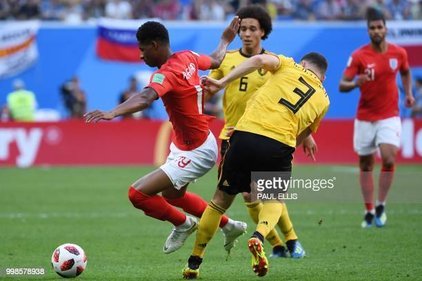 England's forward Marcus Rashford is tackled by Belgium's defender Thomas Vermaelen during their Russia 2018 World Cup playoff for third place...