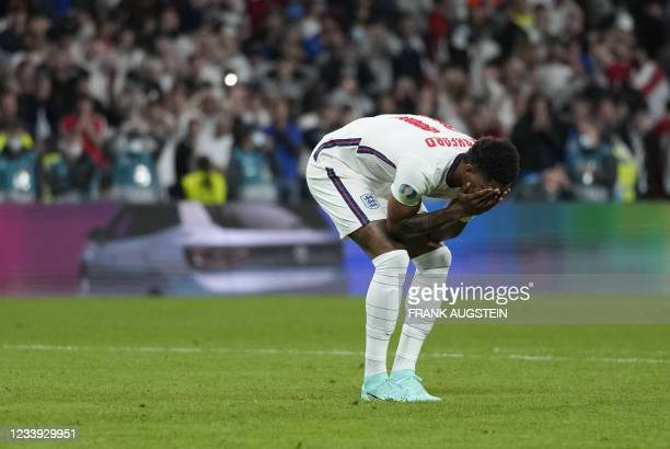 England's forward Marcus Rashford reacts after failing to score in the penalty shootout during the UEFA EURO 2020 final football match between Italy...