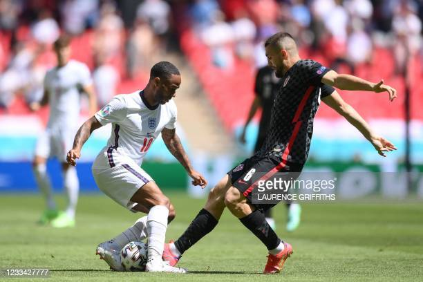 England's forward Raheem Sterling and Croatia's midfielder Mateo Kovacic vie for the ball during the UEFA EURO 2020 Group D football match between...