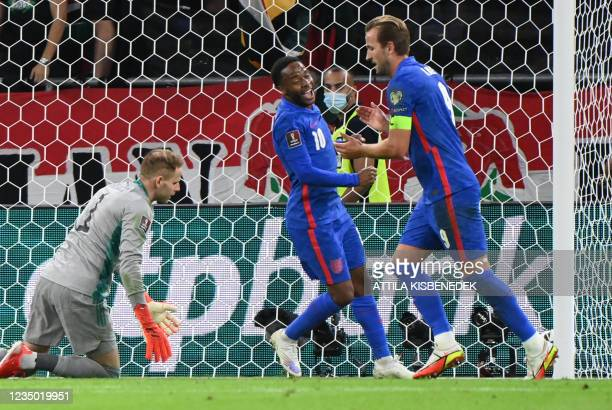 England's forward Raheem Sterling and England's forward Harry Kane celebrate scoring during the FIFA World Cup Qatar 2022 qualification Group I...