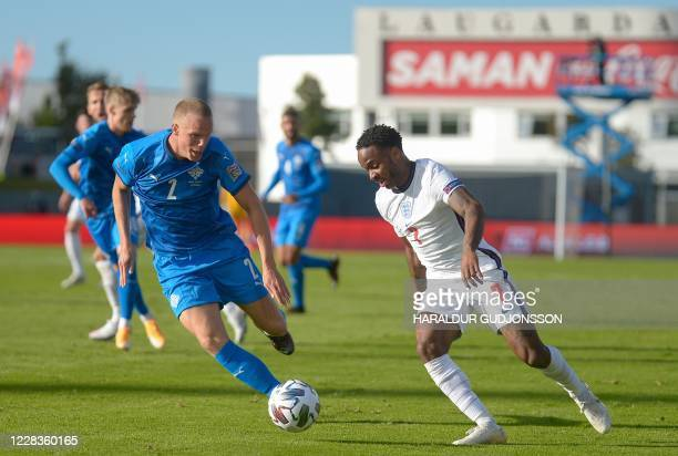 England's forward Raheem Sterling and Iceland's defender Hjortur Hermannsson vie for the ball during the UEFA Nations League football match between...