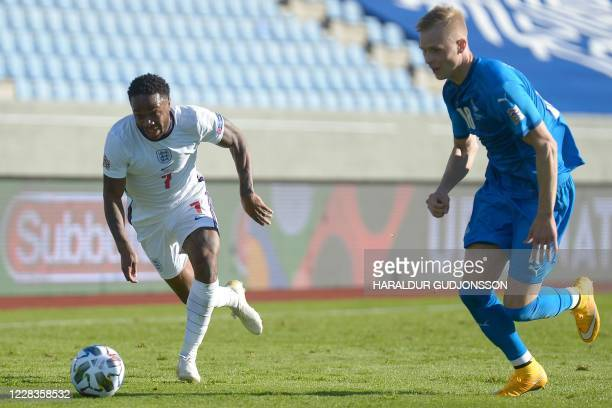 England's forward Raheem Sterling and Iceland's defender Hordur Magnusson vie for the ball during the UEFA Nations League football match between...