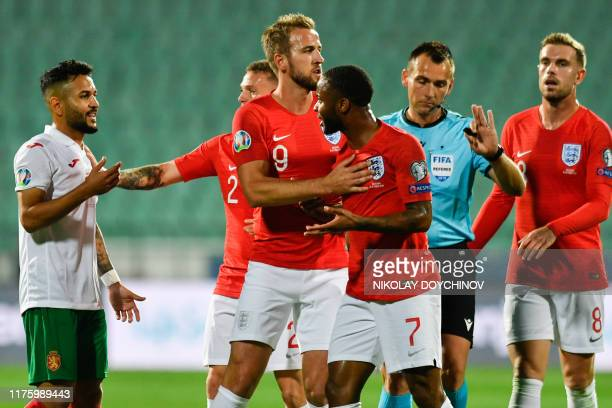 England's forward Raheem Sterling argues with Bulgaria's midfielder Wanderson during the UEFA Euro 2020 qualifier Group A football match between...