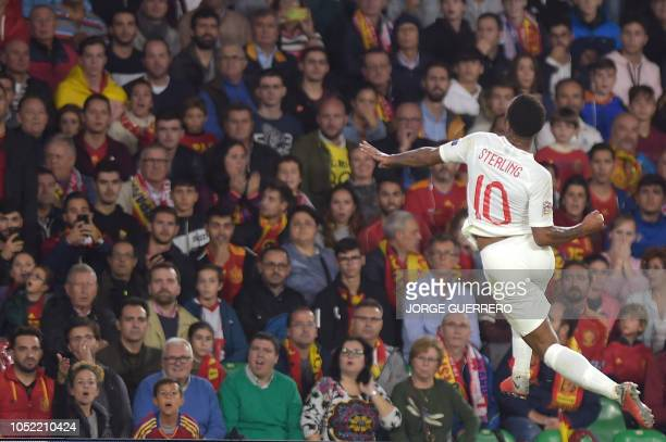 England's forward Raheem Sterling celebrates after scoring during the UEFA Nations League football match between Spain and England on October 15 2018...