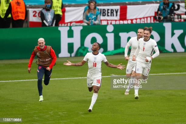 England's forward Raheem Sterling celebrates after scoring the first goal during the UEFA EURO 2020 round of 16 football match between England and...