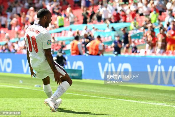 England's forward Raheem Sterling celebrates scoring his team's first goal during the UEFA EURO 2020 Group D football match between England and...