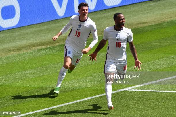 England's forward Raheem Sterling celebrates scoring the team's first goal during the UEFA EURO 2020 Group D football match between England and...