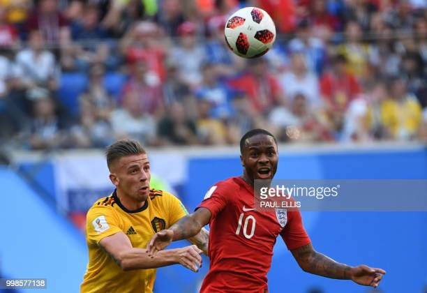 England's forward Raheem Sterling fights for the ball with Belgium's defender Toby Alderweireld during their Russia 2018 World Cup playoff for third...