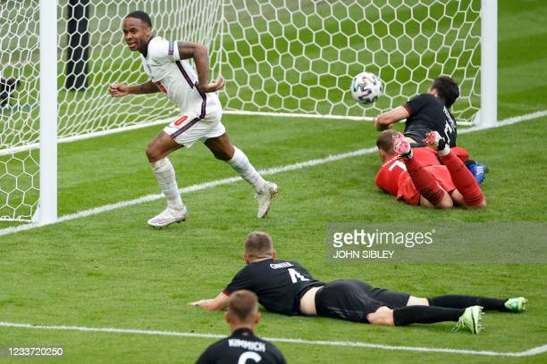 England's forward Raheem Sterling runs to celebrate the first goal during the UEFA EURO 2020 round of 16 football match between England and Germany...