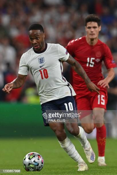 England's forward Raheem Sterling runs with the ball during the UEFA EURO 2020 semi-final football match between England and Denmark at Wembley...