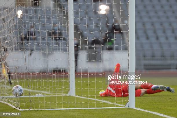 England's forward Raheem Sterling scores from the penalty spot past Iceland's goalkeeper Hannes Halldorsson during the UEFA Nations League football...