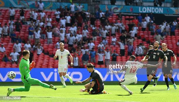 England's forward Raheem Sterling scores his team's first goal during the UEFA EURO 2020 Group D football match between England and Croatia at...