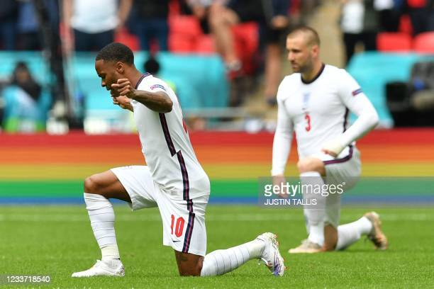 England's forward Raheem Sterling takes a knee ahead of the UEFA EURO 2020 round of 16 football match between England and Germany at Wembley Stadium...