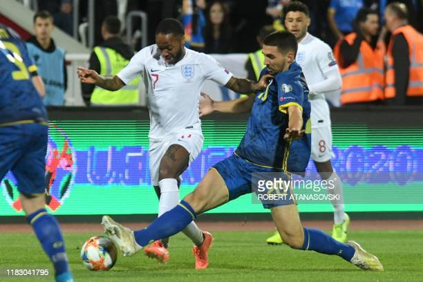 England's forward Raheem Sterling vies with Kosovo's defender Ibrahim Dresevec during the UEFA Euro 2020 qualifying Group A football match between...