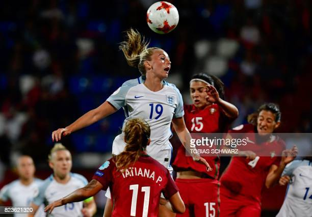 England's forward Toni Duggan and Portugal's defender Carole Costa head the ball during the UEFA Women's Euro 2017 football match between Portugal...