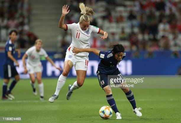 England's forward Toni Duggan vies for the ball with Japan's forward Rikako Kobayashi during the France 2019 Women's World Cup Group D football match...