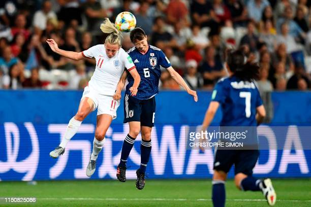 England's forward Toni Duggan vies for the ball with Japan's midfielder Hina Sugita during the France 2019 Women's World Cup Group D football match...