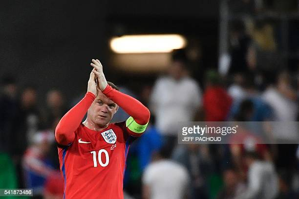 England's forward Wayne Rooney applauds after the Euro 2016 group B football match between Slovakia and England at the GeoffroyGuichard stadium in...