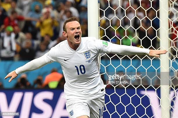 England's forward Wayne Rooney celebrates after scoring past Uruguay's goalkeeper Fernando Muslera during the Group D football match between Uruguay...