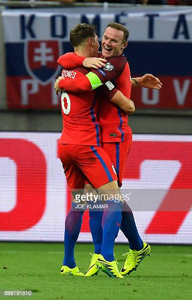 England's forward Wayne Rooney celebrates with England's defender John Stones the winning goal for England during the World Cup 2018 football...