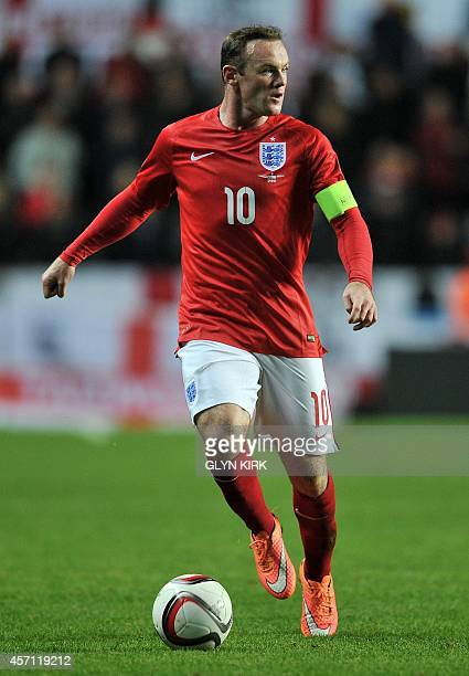 England's forward Wayne Rooney runs with the ball against Estonia during a UEFA 2016 European Championship qualifying group E football match between...