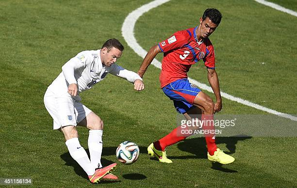 England's forward Wayne Rooney shoots past Costa Rica's defender Giancarlo Gonzalez during the Group D football match between Costa Rica and England...