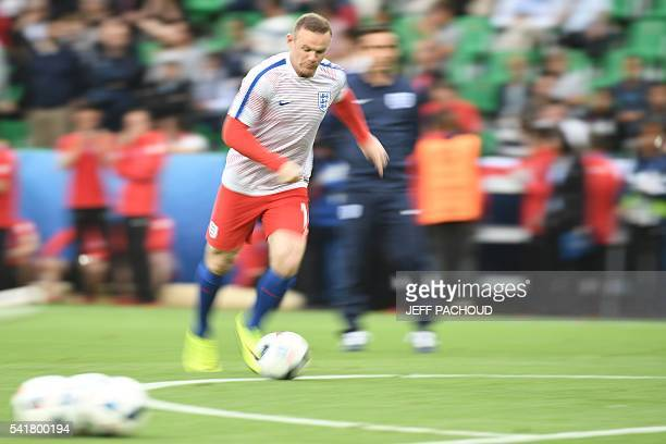 England's forward Wayne Rooney warms up before the Euro 2016 group B football match between Slovakia and England at the GeoffroyGuichard stadium in...