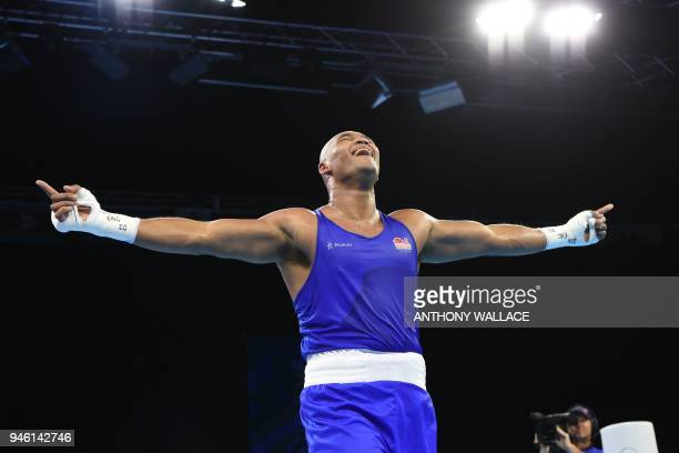TOPSHOT England's Frazer Clarke celebrates his win over India's Satish Kumar during their men's 91kg final boxing match during the 2018 Gold Coast...
