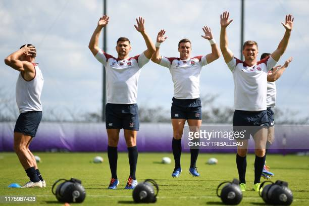 England's full back Elliot Daly fly half George Ford and captain full back Owen Farrell attend a training session at Jissoji Multipurpose Ground in...