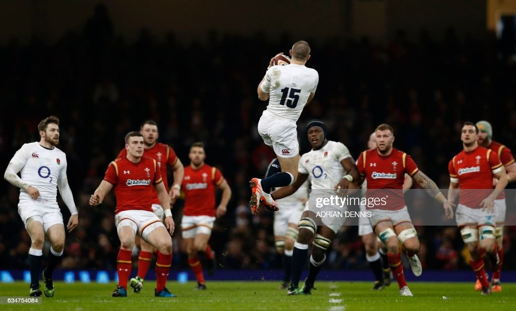 TOPSHOT - England's full back Mike Brown catches a high ball during the Six Nations international rugby union match between Wales and England at the Principality Stadium in Cardiff, south Wales, on February 11, 2017. / AFP PHOTO / Adrian DENNIS / RESTRICTED TO EDITORIAL USE. Use in books subject to Welsh Rugby Union (WRU) approval.