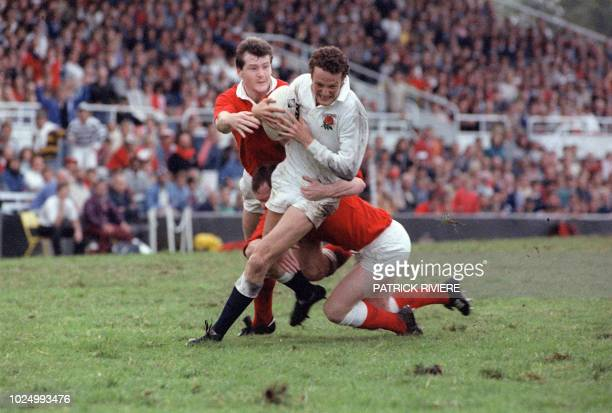 England's fullback Jonathan Webb is tackled by Wales second row Nigel Redmond during the Rugby World Cup Quarter Final game opposing Wales to England...