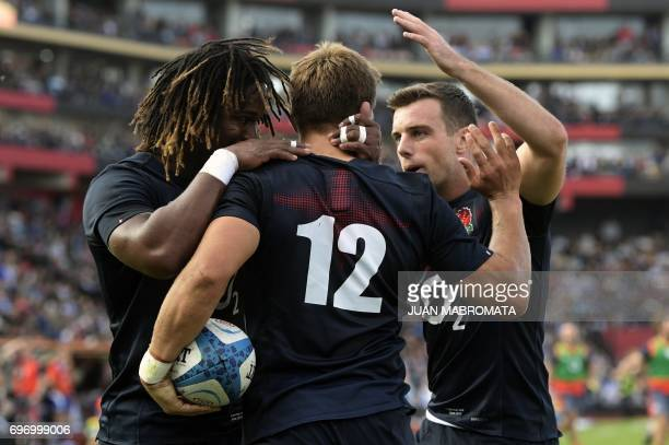 England's fullback Mike Brown is tackled by Argentina's Los Pumas wing Ramiro Moyano and flanker Pablo Matera during their Rugby Union test match at...