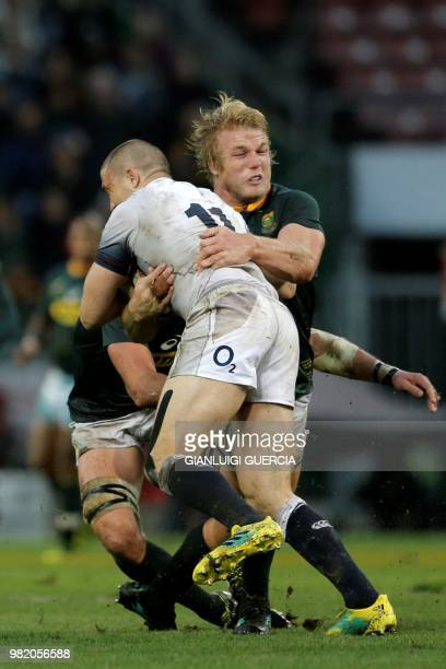 England's fullback Mike Brown is tackled by South Africa's flanker Pieter Steph du Toit during the rugby union Test match between South Africa and...