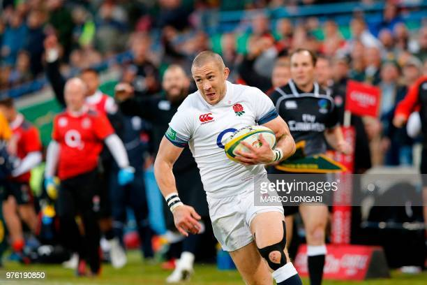 England's fullback Mike Brown runs to score a try during the second test match South Africa vs England at the Free State Stadium in Bloemfontein, on...