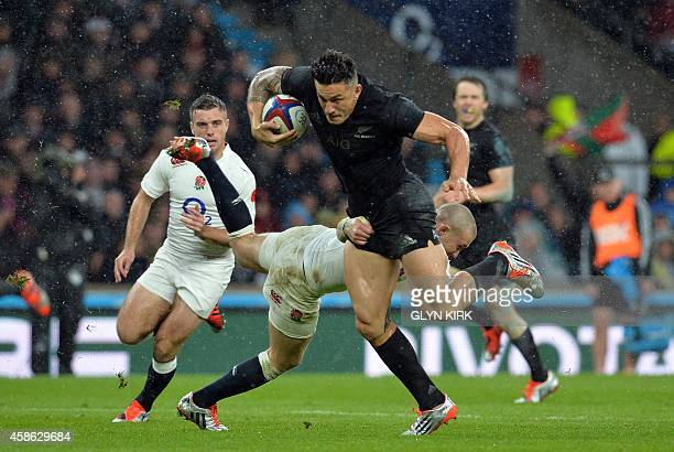 England's fullback Mike Brown tackles New Zealand's centre Sonny Bill Williams during the Autumn international rugby union Test match between England...