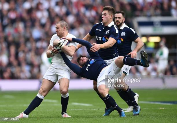 TOPSHOT England's fullback Mike Brown vies with Scotland's scrumhalf Ali Price during the Six Nations international rugby union match between England...