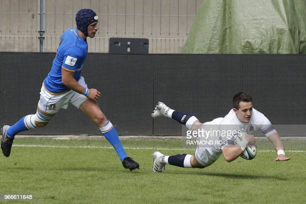 England's fullback Tom Parton scores a try during the Rugby Union World Cup U20 between England and Italy at the Aime Giral Stadium in Perpignan...
