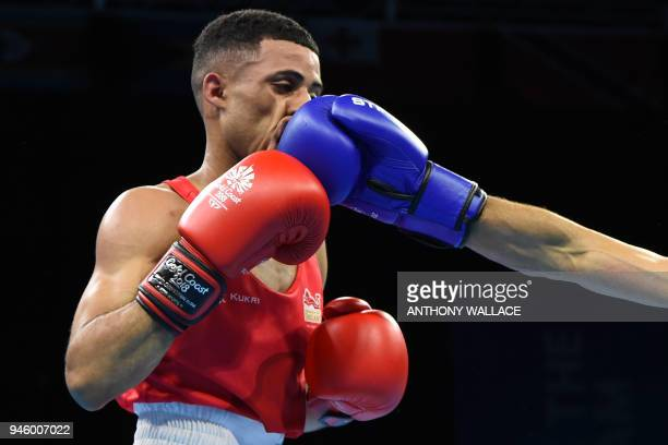 England's Galal Yafai is punched by India's Amit during their men's 4649kg final boxing match during the 2018 Gold Coast Commonwealth Games at the...