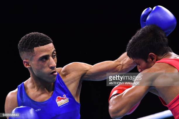 England's Galal Yafai punches Sri Lanka's Thiwanka Ranasinghe during their men's 4649kg semifinal boxing match during the 2018 Gold Coast...