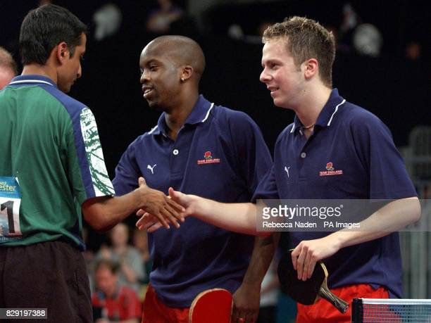 England's Gareth Herbert and Andrew Baggaley shake hands after defeating India's Raman Subramanian and Chetan Panduranga Baboor in the Men's Doubles...