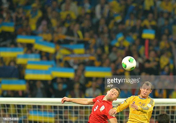 England's Gary Cahill fights for a ball with Ukraine's Roman Zozulya on September 10 2013 during a 2014 FIFA World Cup group H qualifying football...