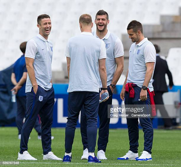 England's Gary Cahill shares a joke with goalkeeping teammates Joe Hart Fraser Forster and Tom Heaton during training session at the Stade Velodrome...