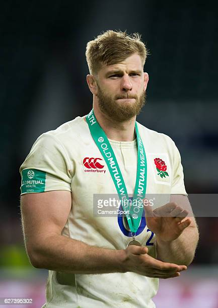 England's George Kruis salutes the fans after the International match between England and Australia at Twickenham Stadium on December 3 2016 in...