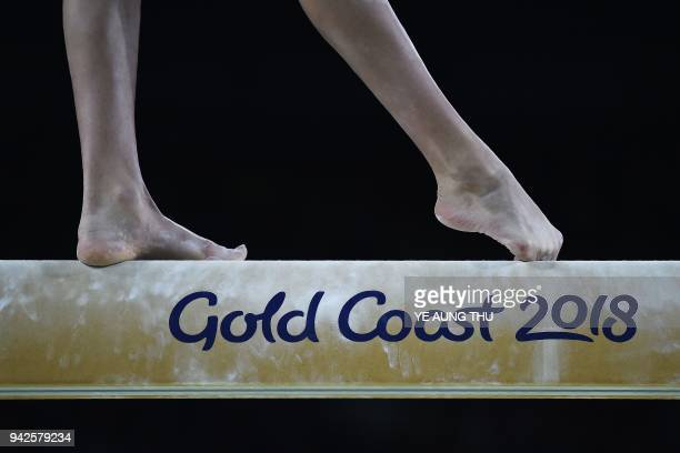 England's Georgia-Mae Fenton competes on the balance beam during the women's team final and individual qualification in the artistic gymnastics event...