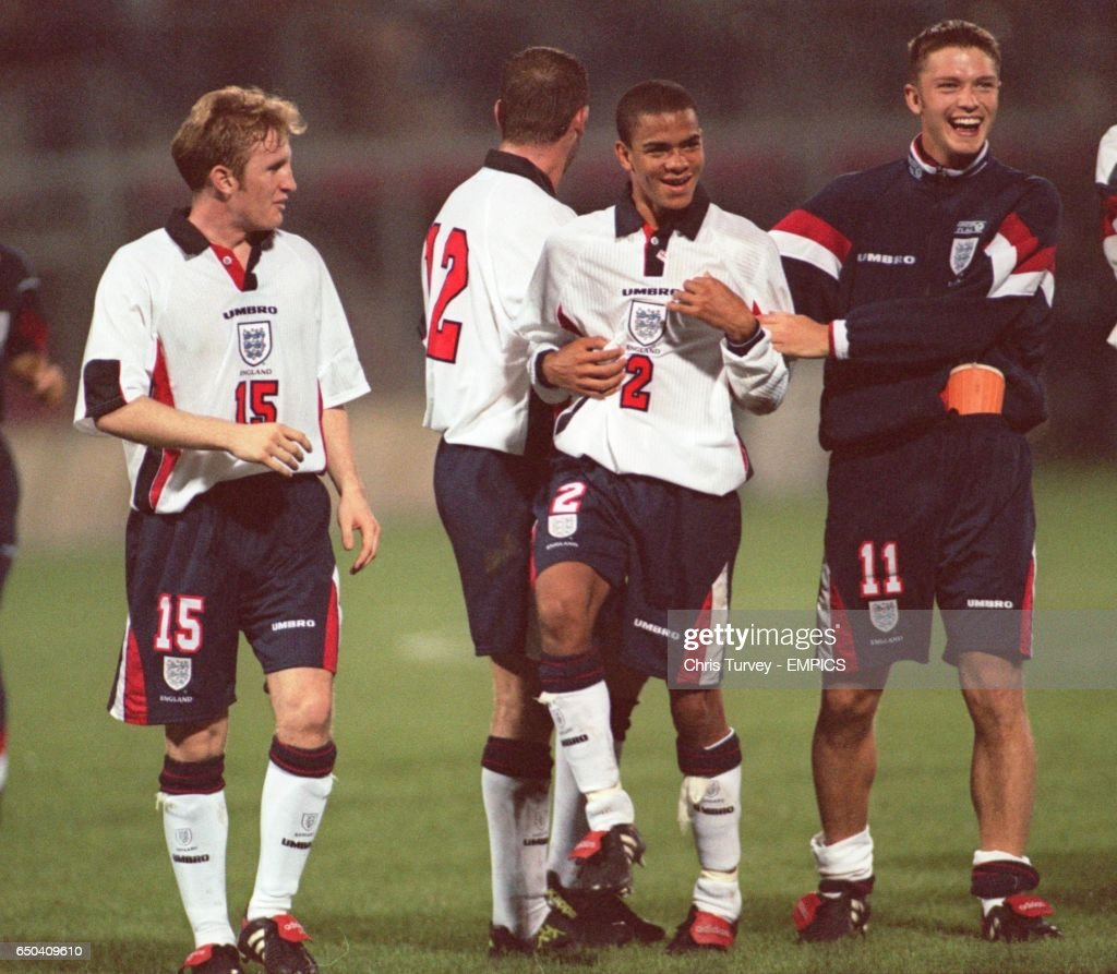 England's goal scorer Kieron Dyer (centre) is congratulated by teammates Lee Bradbury (left) and Stephen Hughes (right) at the end of the game