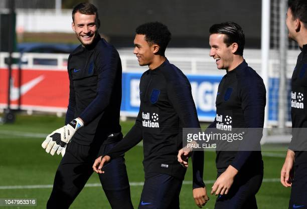 England's goalkeeper Alex McCarthy England's defender Trent AlexanderArnold and England's defender Ben Chilwell attend an open training session at St...