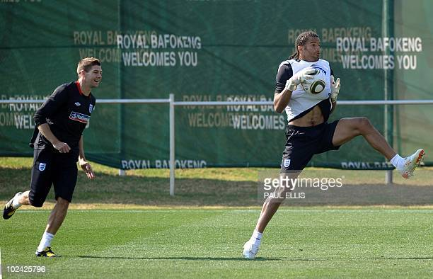 England's goalkeeper David James and midfielder Steven Gerrard compete for the ball during a training session at the Royal Bafokeng Sports Campus...