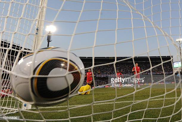 England's goalkeeper David James eyes the ball entering his goal as Germany's midfielder Thomas Mueller scored his team's third goal during the 2010...