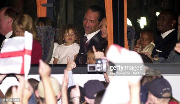 England's goalkeeper David Seaman with daughter Georgina depart onboard the team coach at Heathrow Airport London The England team have arrived back...
